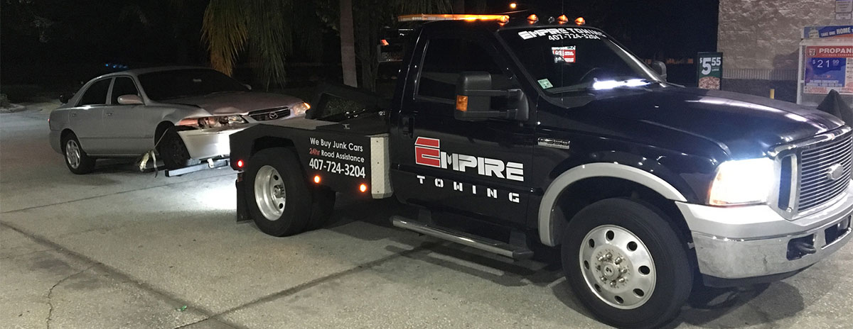 Tow Truck Towing a Wrecked Car - Orlando Towing Service