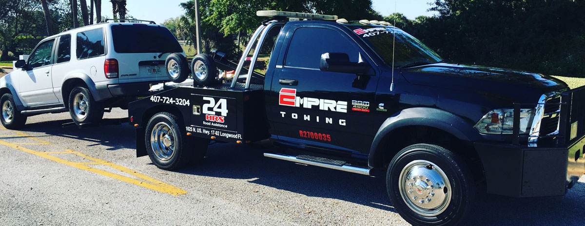 Orlando Towing Service Tow Truck Twoing a White SUV